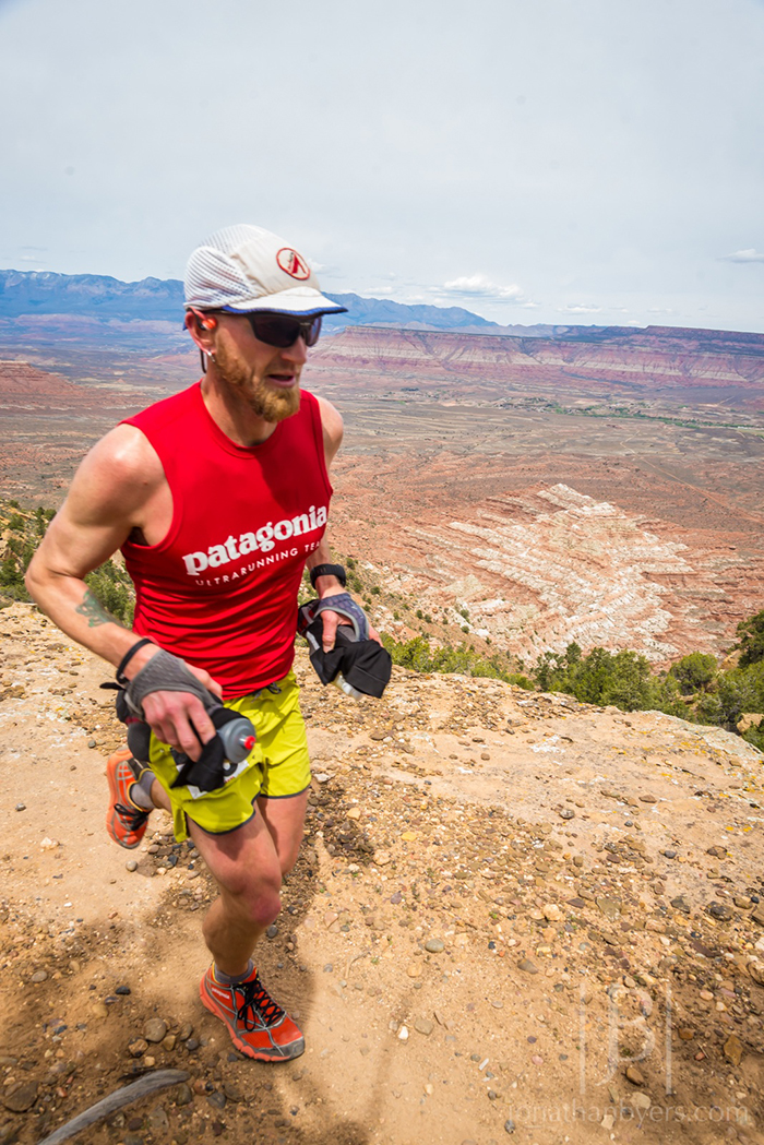 Running along the top of Gooseberry Mesa, mile 31. Photo by Jonathan Byers / jonathanbyers.com